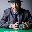 Casino player playing with chips — Stock Photo #9698661
