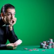 Player in casino and chips — Stock Photo #9698665