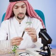 Arab chemist working in lab — Stockfoto #9699384