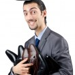 Man with a selection of shoes — Stock Photo #9699409