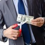 Man cutting money on white — Stock Photo #9699783