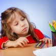 Little girl drawing with pencils — Stockfoto
