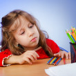 Little girl drawing with pencils — Stock Photo #9699799