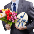 Businessmwith giftbox and flowers — Stock Photo #9815849