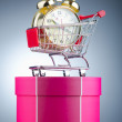 Buying time concept with clock and shopping cart — 图库照片