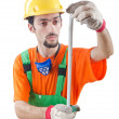 Worker with measuring tape on white - Stockfoto