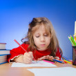 Little girl drawing with pencils — Stock Photo #9817614