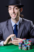 Casino player playing with chips — Stock Photo