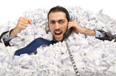 Man with lots of crumpled paper — Stock Photo