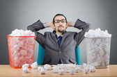 Man with lots of wasted paper — Foto Stock