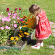 Girl watering flower beds - Lizenzfreies Foto