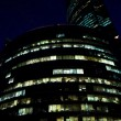 Stock Photo: Modern office building at night, skyscraper