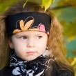 Little girl in a black leather jacket and bandana — Stock Photo #8384226