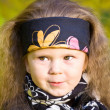 Little girl in a black leather jacket and bandana — Stock Photo #8384262