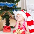 Girl with gifts near a New Year tree — Foto de stock #8384460