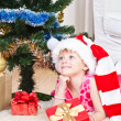 Girl with gifts near a New Year tree - Stockfoto