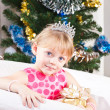 Girl with gifts near a New Year tree — Stock Photo #8384486