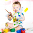 Baby and paints — Stock Photo #8384662
