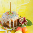 Royalty-Free Stock Photo: Easter cake with candles on a green background. Easter celebrating.