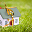 Toy small house with gold bow. — Stock Photo #8384824