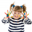 Stock Photo: Girl with hands soiled in paint.