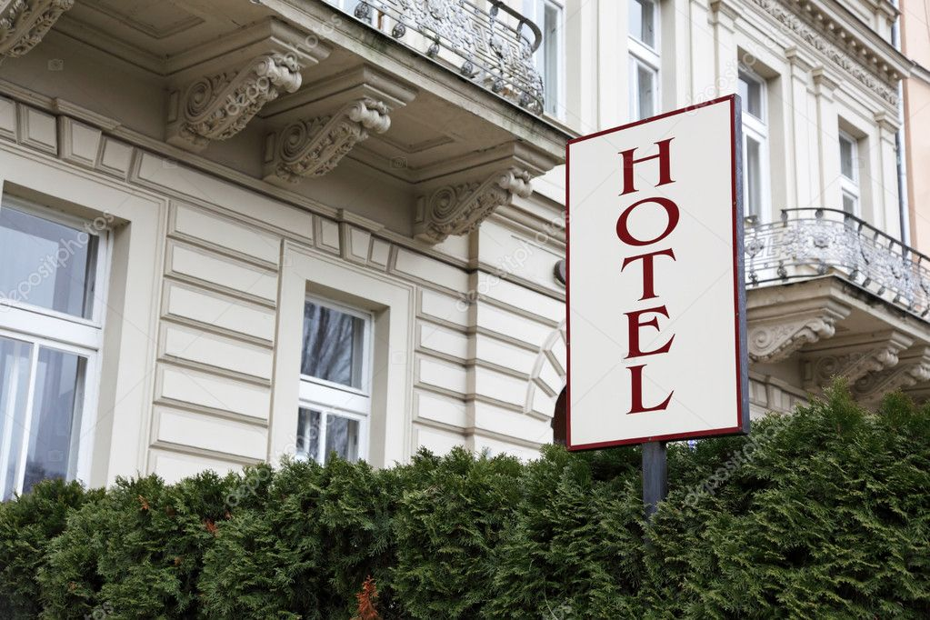 Hotel signboard before an entrance — Stock Photo #10351087