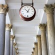 Round clock in a colonnade — Stock Photo #10471159