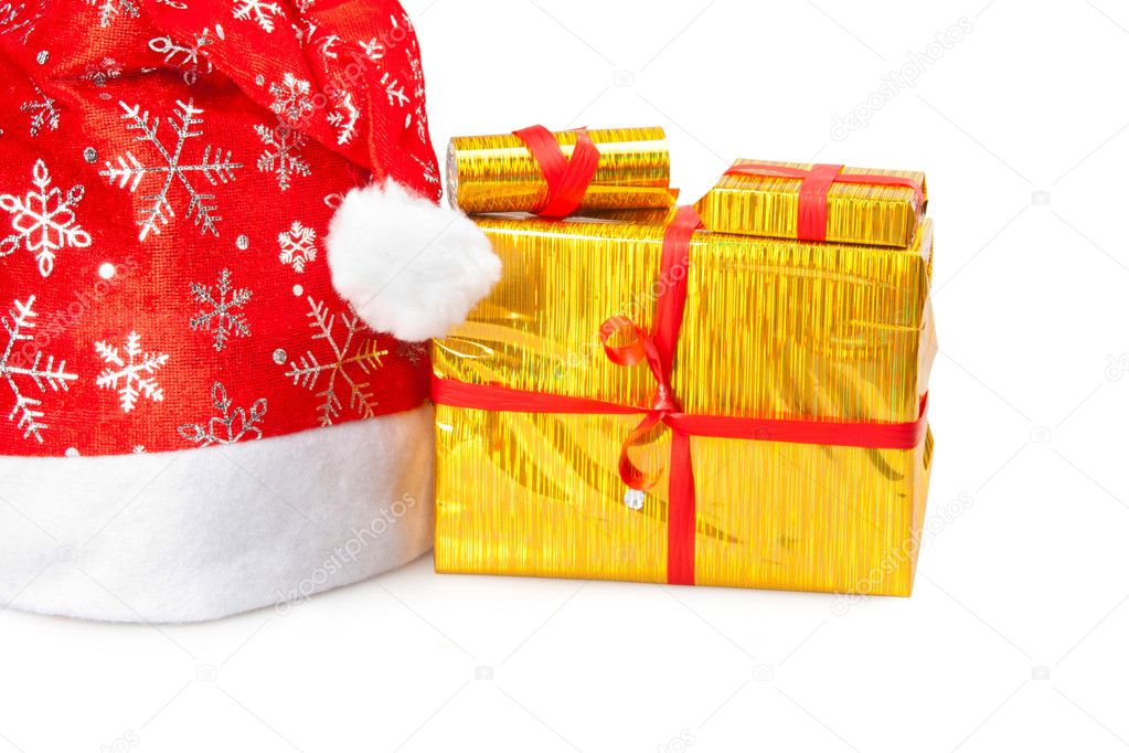 Yellow box and cap of Santa Claus — Stock Photo #9567204
