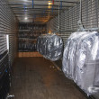 Suits upload to truck - Lizenzfreies Foto