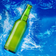 Beer bottle in water — Stock Photo #9548014