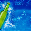 Beer bottle in water — Stock Photo