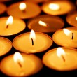 Candles shining in darkness - Foto Stock