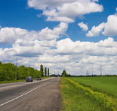 Fields, road and Sky — Stock Photo