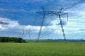 Power line and windmill — Stock Photo