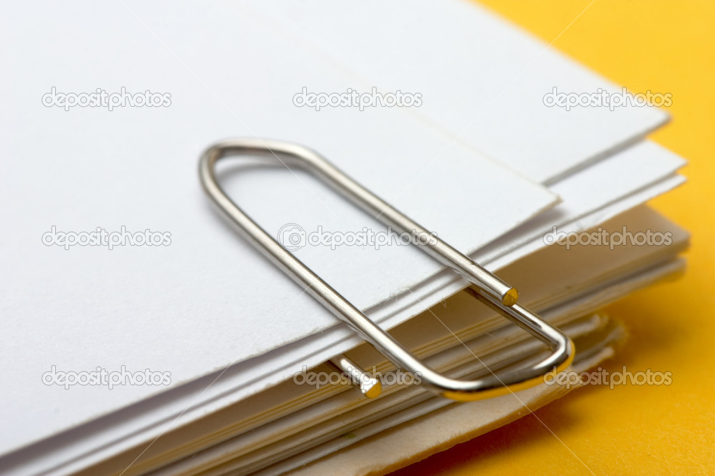 View of a paper clip with stack of blank paper  Stock Photo #9546484