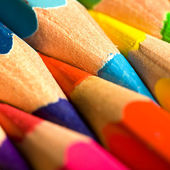 Colored pencils in a row — Stock Photo
