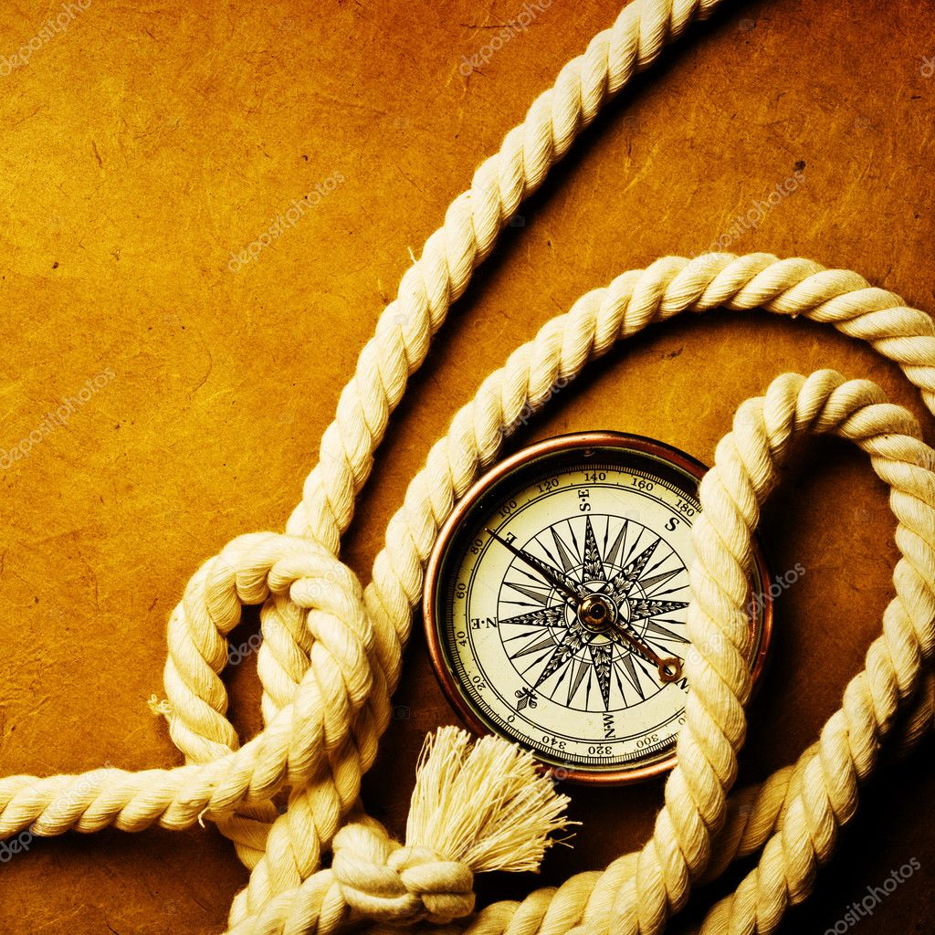 Compass on old textured paper with copyspace — Stock Photo #9551817