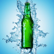 Beer bottle being poured in a water — Stock Photo #9594918