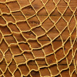 Old rope and fishing net on old wood board — Stock Photo