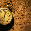 Royalty-Free Stock Photo: Pocket clock on old paper