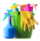 Cleaning supplies in a green bucket — Stock Photo
