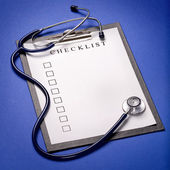 Stethoscope and clipboard — Stock Photo