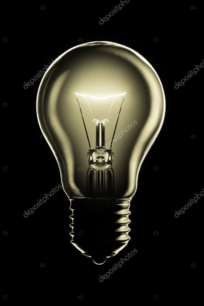 Glowing lamp on black background — Stock Photo #9597395
