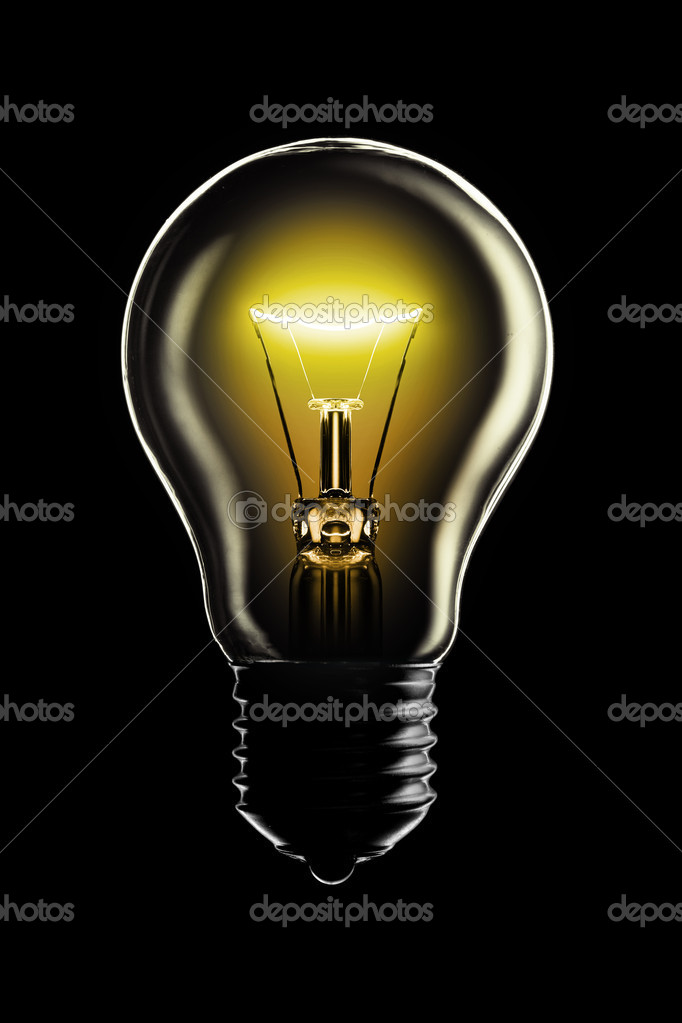 Glowing lamp on black background  Stock Photo #9597415