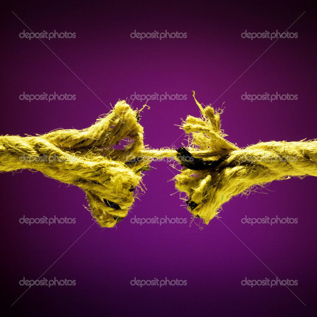 Frayed rope breaking on a dark background  Stock Photo #9599139