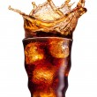 Cola splashing — Stock Photo