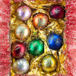 Different colored christmas balls — Stock fotografie