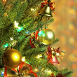 Christmas fir tree with colorful lights close up — Stock Photo