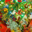 Christmas fir tree with colorful lights close up — Photo