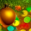 Christmas fir tree with colorful lights close up — ストック写真